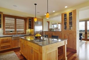 Craftsman Kitchen with Pendant light, Flat panel cabinets, Glass panel, Flush, Undermount sink, Farmhouse sink, Stone Tile