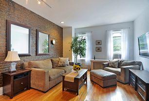 Modern Living Room with double-hung window, can lights, Standard height, Built-in bookshelf, Hardwood floors
