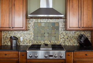 Craftsman Kitchen with One-wall, Wall Hood, electric cooktop, Standard height, Soapstone counters, Flat panel cabinets