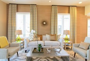 Contemporary Living Room with Carpet, Safavieh orbit the sun mirror, Tov clyde arm chair, interior wallpaper