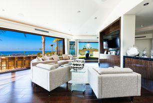 Contemporary Living Room with Built-in bookshelf, Crown molding, Hardwood floors