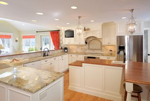 Traditional Kitchen with U-shaped, Pendant light, High ceiling, Hardwood floors, Complex granite counters, Custom hood, Flush