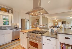 Craftsman Kitchen with Inset cabinets, European Cabinets, Wood counters, Soapstone counters, Crown molding, Farmhouse sink