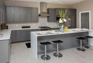 Contemporary Kitchen with built-in microwave, Corian counters, Undermount sink, gas range, European Cabinets, Flush, L-shaped