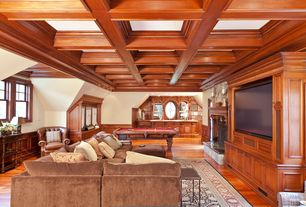 Traditional Game Room with Hardwood floors, metal fireplace, Crown molding, Box ceiling, Wainscotting, Built-in bookshelf