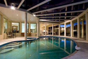 Contemporary Swimming Pool with Skylight, exterior tile floors, picture window, Indoor pool, can lights, sliding glass door