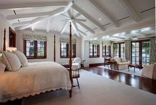 Traditional Master Bedroom with Casement, Hardwood floors, Exposed beam, Crown molding, can lights, High ceiling, Ceiling fan