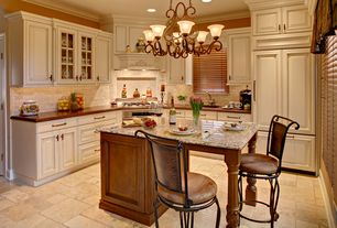 Traditional Kitchen with limestone tile floors, L-shaped, Stone Tile, Custom hood, Glass panel, Undermount sink, Raised panel