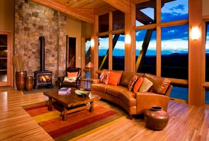 Rustic Living Room with Fireplace, picture window, Wood Stove fireplace, Exposed beam, Hardwood floors, Wall sconce