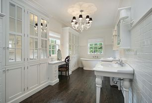 Traditional Master Bathroom with Durasupreme Cabinets - Hanover Style Panel in White, Glass panel, Chandelier, Freestanding