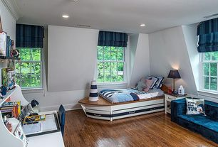 Traditional Kids Bedroom with no bedroom feature, Casement, can lights, Window seat, Laminate floors, Built-in bookshelf