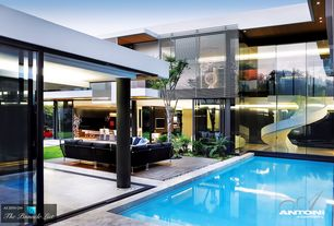 Contemporary Swimming Pool with exterior stone floors, Lap pool, Outdoor seating, Courtyard, Exterior shutters, Pathway