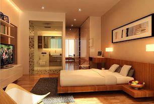 Modern Master Bedroom with Hardwood floors, Built-in bookshelf