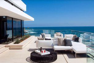 Contemporary Deck with exterior tile floors, Raised beds, Deck Railing, picture window, exterior concrete tile floors