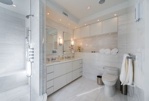 Contemporary Master Bathroom with frameless showerdoor, European Cabinets, Corian counters, Wall sconce, Undermount sink