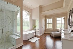 Contemporary Master Bathroom with Crown molding, double-hung window, Arizona tile, CALACATTA GOLD VEIN, Marble, Chandelier