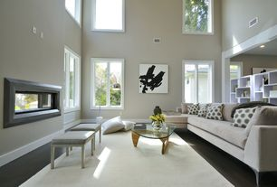 Contemporary Living Room with Laminate floors, High ceiling