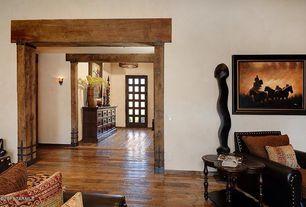Rustic Hallway with Wall sconce, Hardwood floors, Glass panel door, Pendant light, Built-in bookshelf