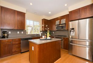 Traditional Kitchen with Simple granite counters, dishwasher, Multiple Sinks, built-in microwave, Multiple Refrigerators