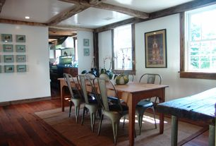 Rustic Dining Room with Box ceiling, Hardwood floors, double-hung window, Standard height, can lights, Exposed beam
