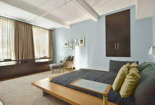 Contemporary Guest Bedroom with Hardwood floors, Exposed beam, Built-in bookshelf