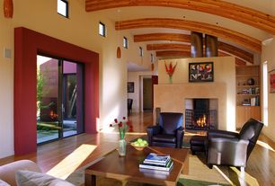 Modern Living Room with Fireplace screen, Hardwood floors, Curved ceiling, Pottery Barn Irving Leather Swivel Armchair