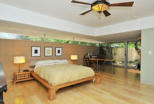 Contemporary Master Bedroom with Laminate floors, picture window, Ceiling fan, sliding glass door, Standard height