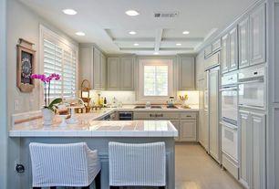 Traditional Kitchen with limestone tile floors, stone tile floors, dishwasher, Undermount sink, U-shaped, Crown molding