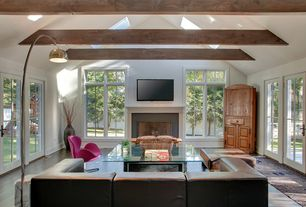 Eclectic Living Room with Exposed beam, Hardwood floors, flush light, Skylight, High ceiling, French doors