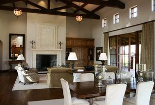 Traditional Great Room with French doors, Fireplace, Built-in bookshelf, Chandelier, High ceiling, picture window, can lights