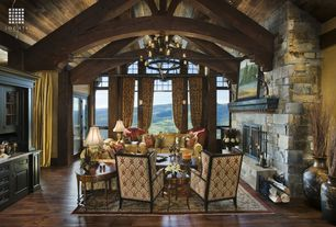 Country Great Room with Wall sconce, High ceiling, Fireplace, Chandelier, French doors, double-hung window, Hardwood floors