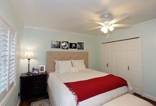 Traditional Master Bedroom with Ceiling fan, Hardwood floors, Crown molding, Built-in bookshelf