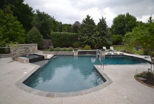 Traditional Swimming Pool with Pool with hot tub, Pathway, exterior stone floors, Raised beds, Fence