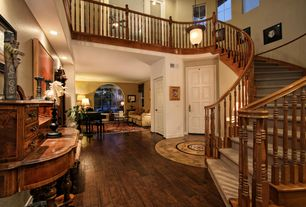 Traditional Entryway with High ceiling, Loft, Hardwood floors, Pendant light