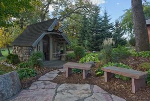 Cottage Landscape/Yard with picture window, exterior stone floors, Pathway, Raised beds