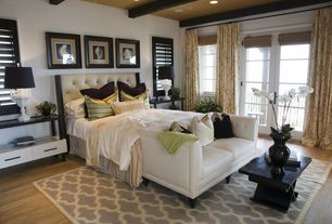 Traditional Master Bedroom with French doors, Hardwood floors, Exposed beam