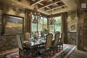 Rustic Dining Room with Columns, can lights, High ceiling, Exposed beam, Hardwood floors, Chandelier, picture window