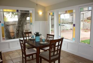 Traditional Dining Room with Wainscotting, Stained glass window, limestone floors, Wall sconce