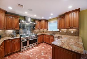 Traditional Kitchen with double oven range, specialty window, Ceramic Tile, Raised panel, full backsplash, Standard height