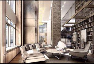 Contemporary Living Room with flush light, Hardwood floors, Window seat, Chandelier, Built-in bookshelf, womb chair & ottoman