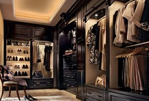 Traditional Closet with travertine tile floors, Crown molding, Built-in bookshelf, can lights, Standard height
