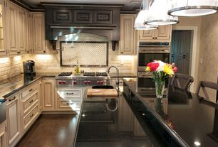 "Traditional Kitchen with Hardwood floors, Raised panel, Wolf 48"" sealed burner rangetop - 6 burners and infrared griddle"