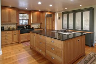 Country Kitchen with Simple granite counters, can lights, full backsplash, Limestone Tile, Multiple Sinks, Farmhouse sink