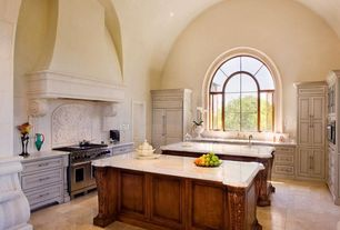 Mediterranean Kitchen with U-shaped, Raised panel, specialty door, Arched window, Inset cabinets, Undermount sink