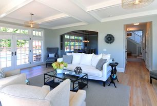 Traditional Living Room with double-hung window, Standard height, French doors, Exposed beam, flush light, Transom window