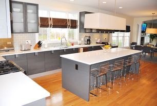 Modern Kitchen with Ikea Tobias Side Chair, Dupont Corian Designer White, Maple - Cinnamon 3 1/4 in. Solid Hardwood Plank