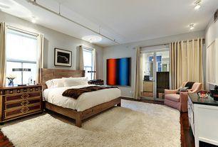 Eclectic Master Bedroom with Standard height, French doors, Hardwood floors, flush light, Casement