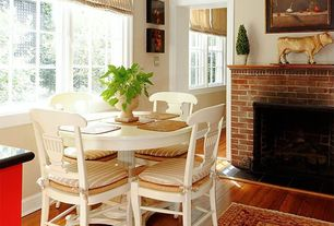 Country Dining Room with Hardwood floors, Paint 2, Standard height, Paint 1, Casement, brick fireplace, Paint, Fireplace