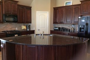 Traditional Kitchen with Inset cabinets, Dura Supreme Cabinetry Hampton Classic Panel, limestone tile floors, Raised panel