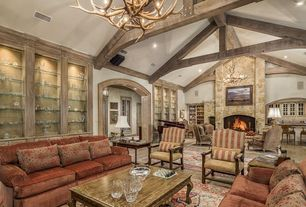 Traditional Great Room with High ceiling, Concrete floors, Fireplace, Exposed beam, can lights, stone fireplace, Chandelier